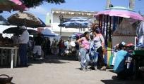<h5>Umbrella city</h5><p>A view of the tables and umbrellas at the La Penita Market.</p>